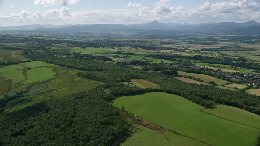 6K stock footage aerial video of forests and farm fields, Kippen, Scotland Aerial Stock Footage | AX110_030