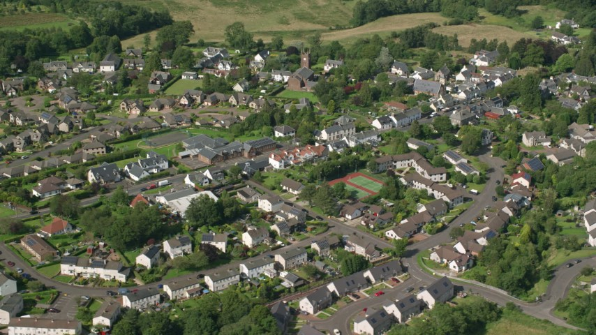 6K stock footage aerial video of orbiting a Scottish village, Kippen, Scotland Aerial Stock Footage | AX110_033