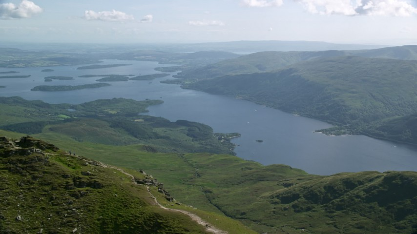 6K stock footage aerial video of Loch Lomond seen from Ben Lomond, Scottish Highlands, Scotland Aerial Stock Footage | AX110_051