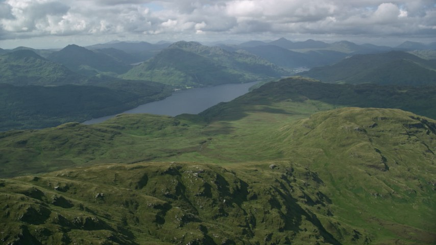 6K stock footage aerial video approach Loch Lomond and mountains, Scottish Highlands, Scotland Aerial Stock Footage | AX110_054