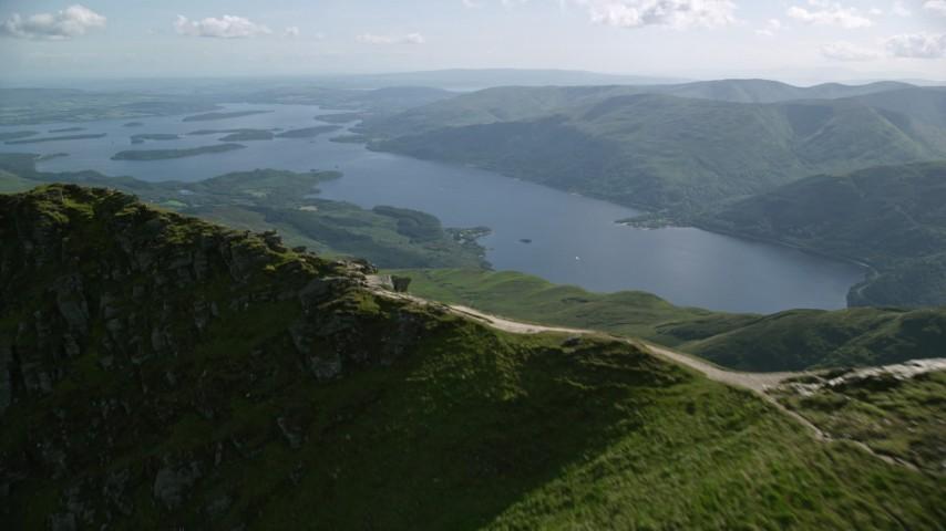 6K stock footage aerial video approach Loch Lomond from Ben Lomond in Scottish Highlands, Scotland Aerial Stock Footage | AX110_055