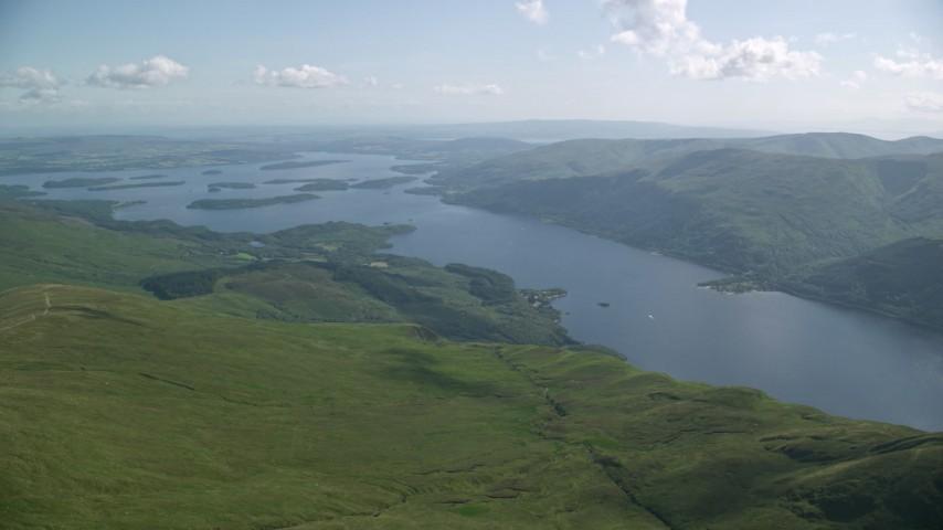 6K stock footage aerial video of Loch Lomond seen from Ben Lomond, Scottish Highlands, Scotland Aerial Stock Footage | AX110_056
