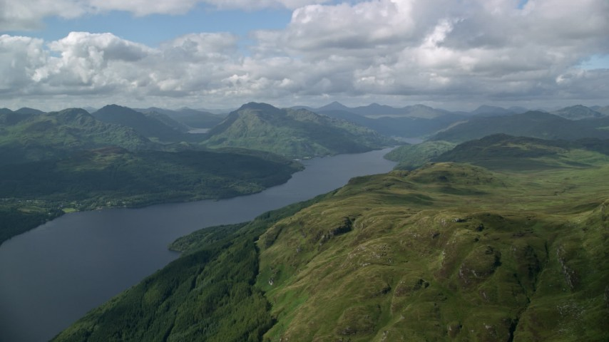 6K stock footage aerial video of Loch Lomond and mountains, Scottish Highlands, Scotland Aerial Stock Footage | AX110_057