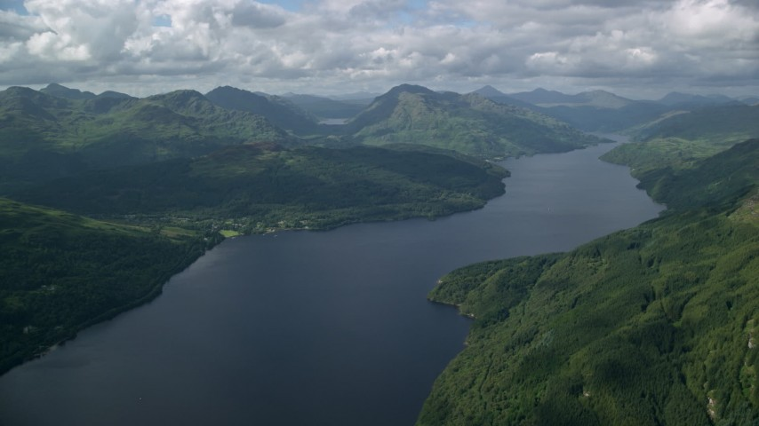 6K stock footage aerial video of calm waters of Loch Lomond, Scottish Highlands, Scotland Aerial Stock Footage | AX110_059