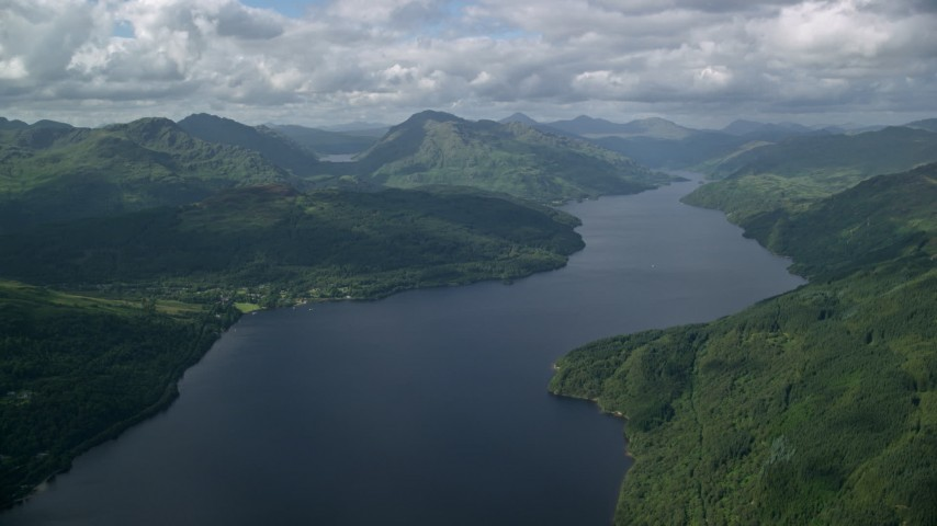 6K stock footage aerial video of green mountains and calm waters of Loch Lomond, Scottish Highlands, Scotland Aerial Stock Footage | AX110_060
