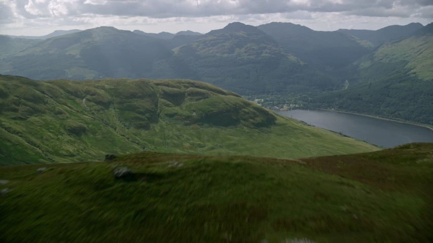 6K stock footage aerial video fly over mountain and reveal Loch Long, Scottish Highlands, Scotland Aerial Stock Footage | AX110_065