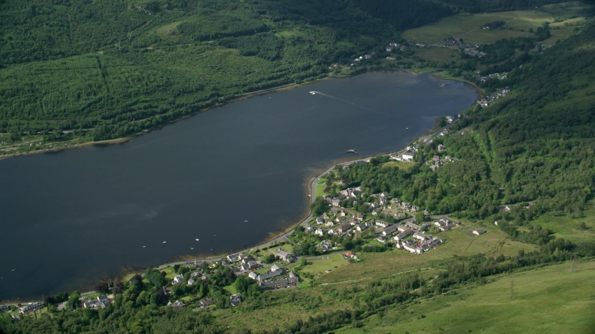 6K stock footage aerial video of a village on the shore of Loch Long, Arrochar, Scottish Highlands, Scotland Aerial Stock Footage | AX110_067