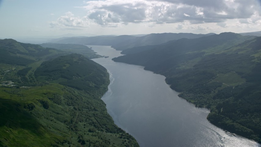6K stock footage aerial video of Loch Long flowing between lush green mountains, Scottish Highlands, Scotland Aerial Stock Footage | AX110_068