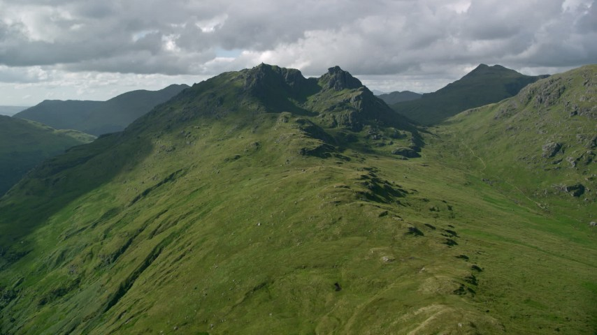 6K stock footage aerial video approach a green mountain, The Cobbler, Scottish Highlands, Scotland Aerial Stock Footage | AX110_070