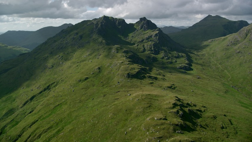 6K stock footage aerial video approach The Cobbler in Scottish Highlands, Scotland, United Kingdom Aerial Stock Footage | AX110_071