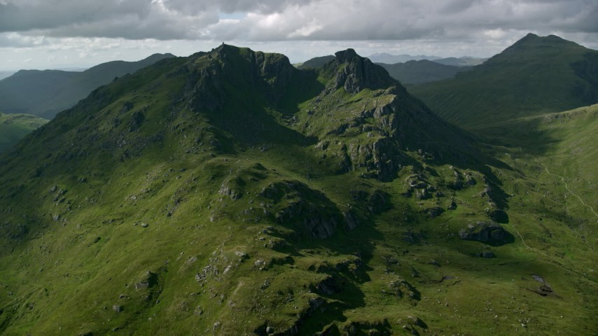 6K stock footage aerial video approach The Cobbler, a green mountain peak, Scottish Highlands, Scotland Aerial Stock Footage AX110_072 | Axiom Images