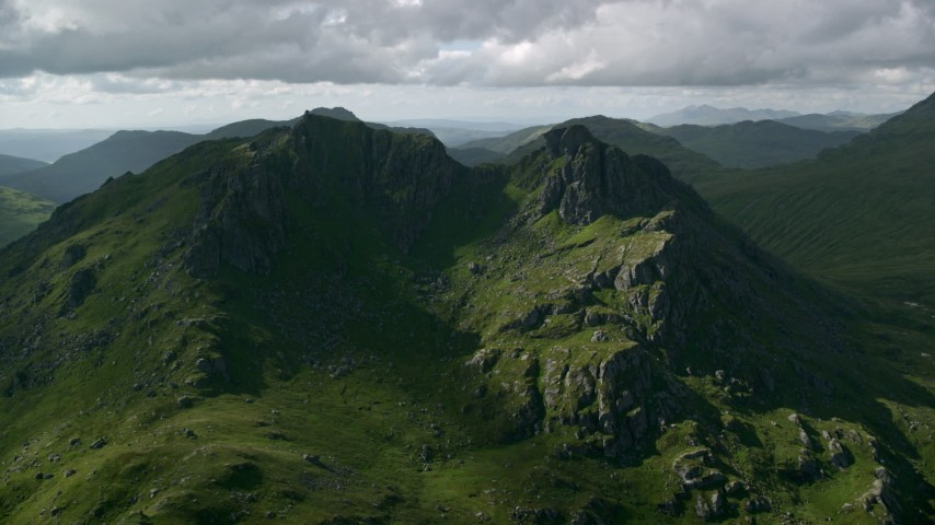 6K aerial video of The Cobbler, a green mountain peak, Scottish Highlands, Scotland Aerial Stock Footage AX110_073