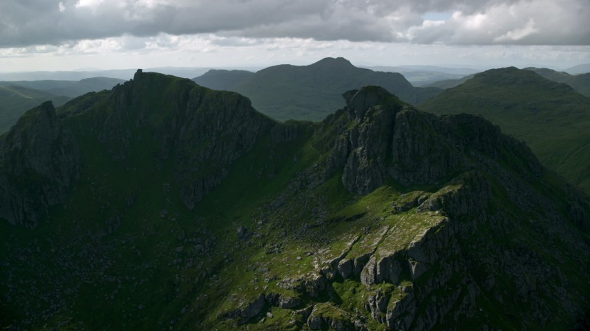 6K aerial video of The Cobbler, a green mountain peak, Scottish Highlands, Scotland Aerial Stock Footage | AX110_074