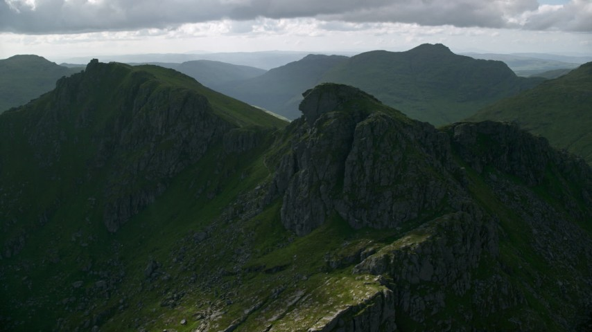 6K stock footage aerial video of The Cobbler, a green peak, Scottish Highlands, Scotland Aerial Stock Footage | AX110_075
