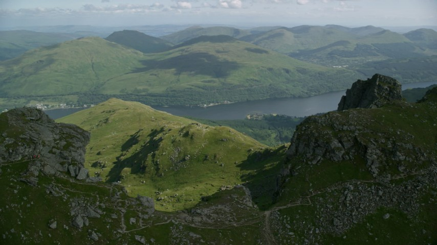 6K aerial video of orbiting The Cobbler with views of Loch Long, Scottish Highlands, Scotland Aerial Stock Footage | AX110_078