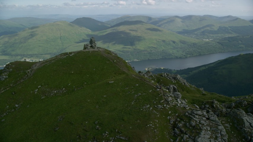 6K aerial video of orbiting The Cobbler with views of Loch Long, Scottish Highlands, Scotland Aerial Stock Footage | AX110_079