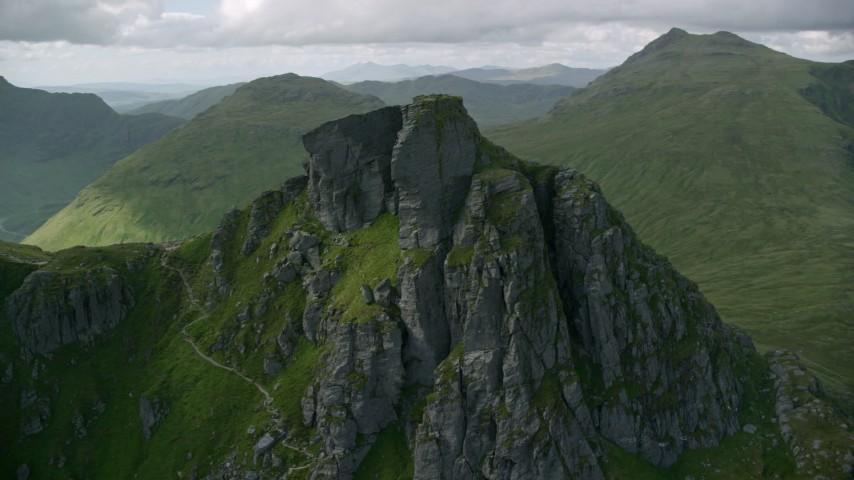 6K stock footage aerial video of orbiting a jagged summit of The Cobbler, Scottish Highlands, Scotland Aerial Stock Footage | AX110_083