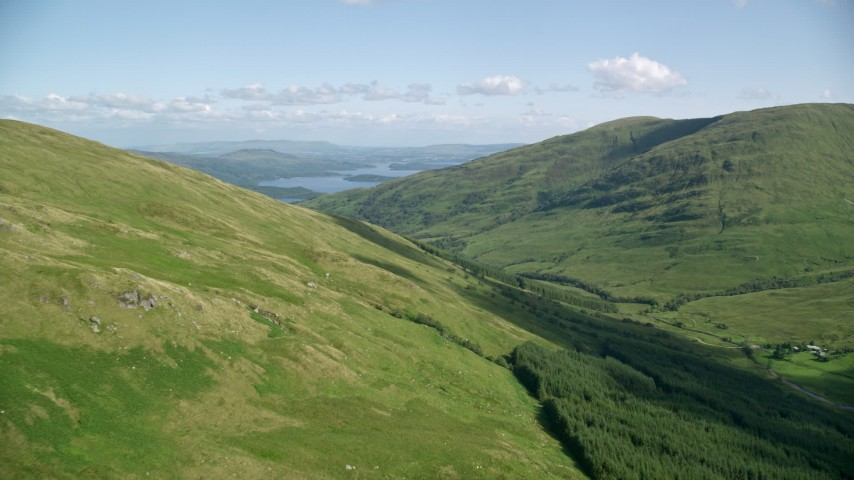 6K stock footage aerial video approach Beinn Dubh with Loch Lomond in the distance, Scottish Highlands, Scotland Aerial Stock Footage | AX110_097
