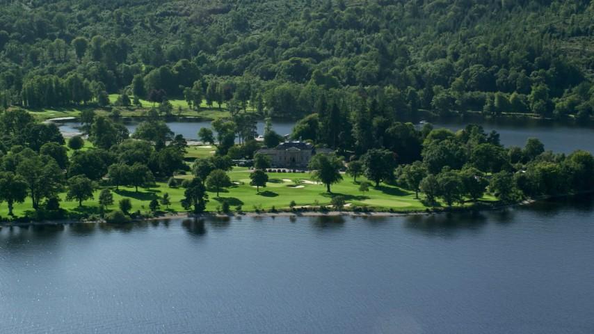 6K stock footage aerial video approach Rossdhu Mansion at Loch Lomond Golf Course, Luss, Scottish Highlands, Scotland Aerial Stock Footage | AX110_113