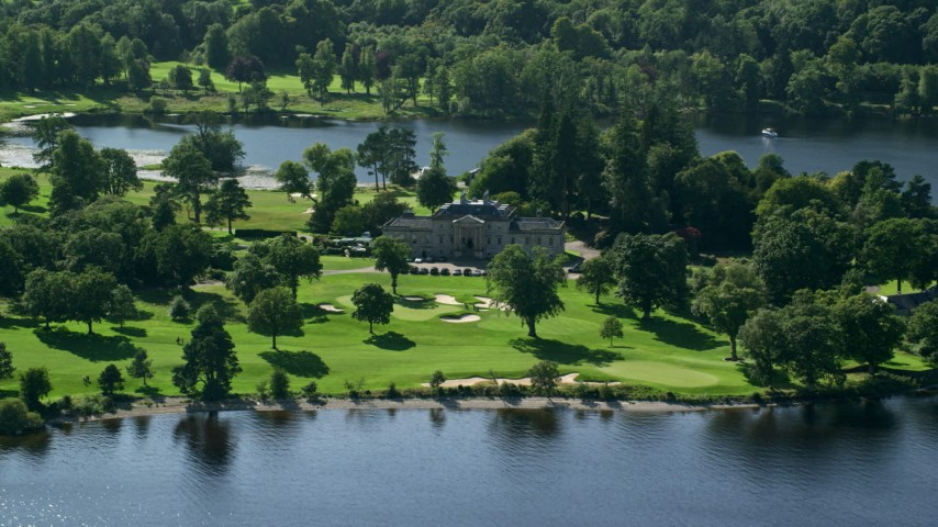 6K stock footage aerial video of an approach to Rossdhu Mansion at Loch Lomond Golf Course, Luss, Scottish Highlands, Scotland Aerial Stock Footage | AX110_114