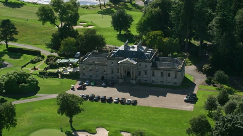 6K stock footage aerial video fly over Rossdhu Mansion at Loch Lomond Golf Course, Luss, Scottish Highlands, Scotland Aerial Stock Footage | AX110_115