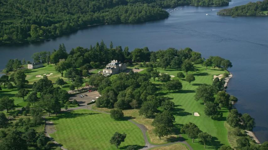 6K stock footage aerial video of Rossdhu Mansion at Loch Lomond Golf Course, Luss, Scottish Highlands, Scotland Aerial Stock Footage | AX110_119