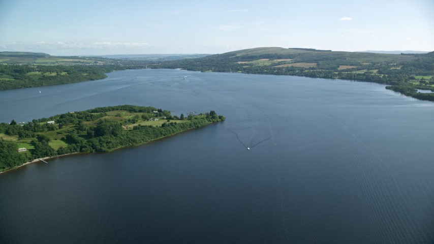 6K stock footage aerial video fly over Loch Lomond, Scottish Highlands, Scotland Aerial Stock Footage | AX110_122