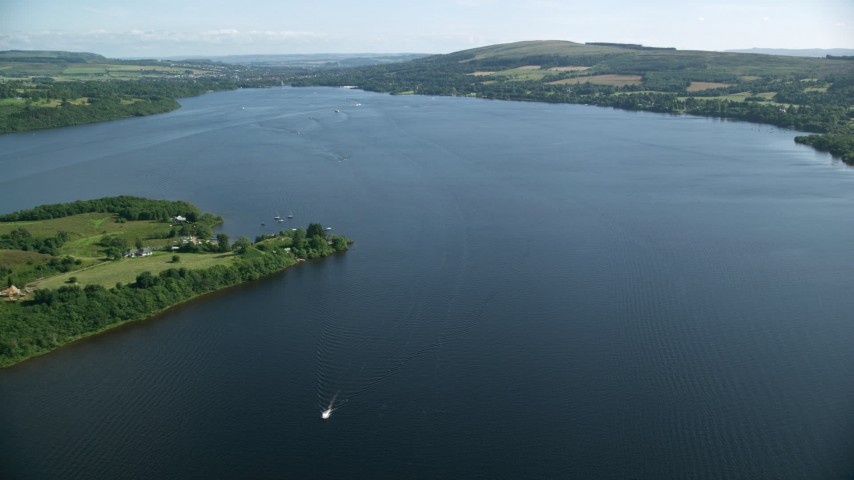 6K stock footage aerial video fly over Loch Lomond, Scottish Highlands, Scotland Aerial Stock Footage | AX110_123