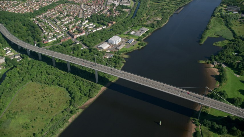 6K stock footage aerial video approach Erskine Bridge near neighborhoods in Glasgow, Scotland Aerial Stock Footage | AX110_144