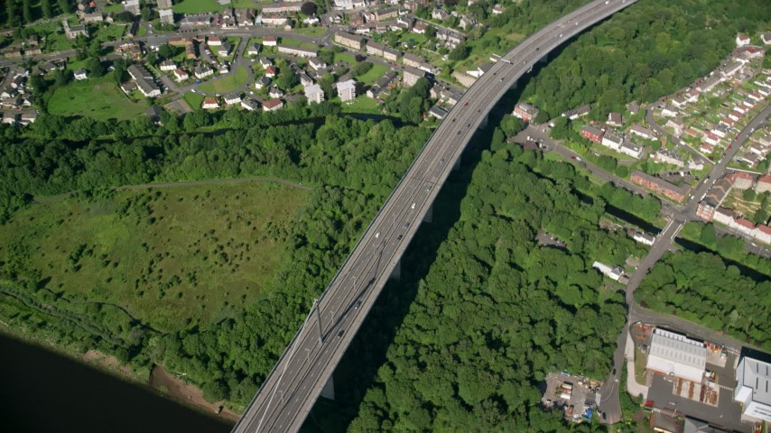 6K stock footage aerial video of a bird's eye orbit of Erskine Bridge by residential neighborhoods, Glasgow, Scotland Aerial Stock Footage | AX110_145