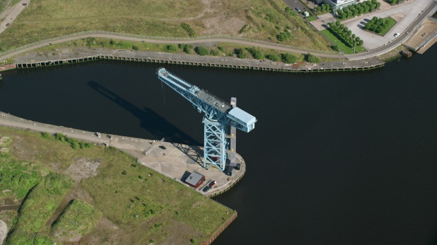 6K stock footage aerial video approach Clydebank Titan Crane in Glasgow, Scotland Aerial Stock Footage | AX110_148