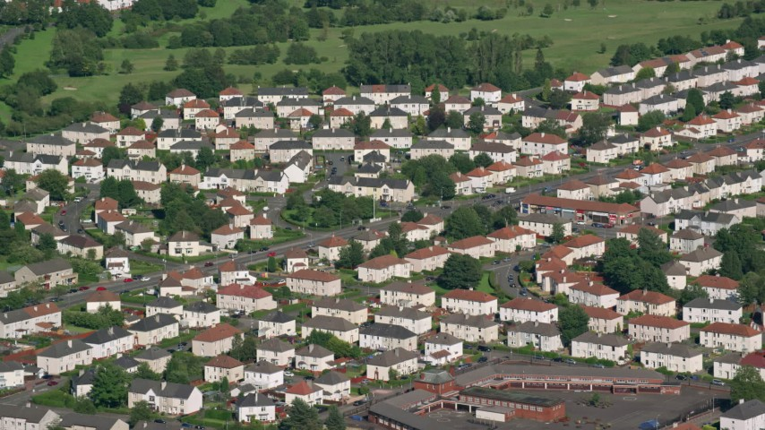 6K stock footage aerial video of town houses in residential neighborhoods, Glasgow, Scotland Aerial Stock Footage | AX110_149