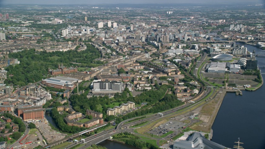 6K stock footage aerial video of approaching the city of Glasgow, Scotland Aerial Stock Footage | AX110_154