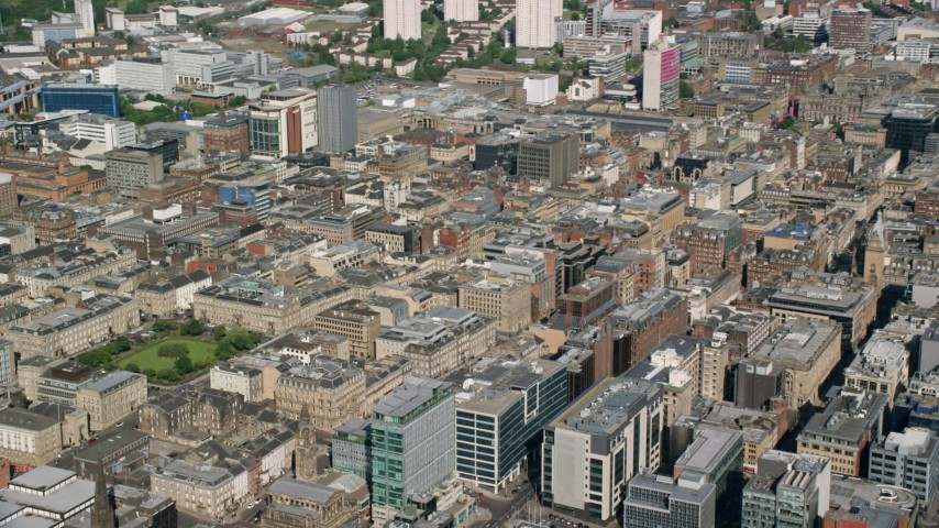 6K stock footage aerial video of city office buildings, Glasgow, Scotland Aerial Stock Footage AX110_158 | Axiom Images
