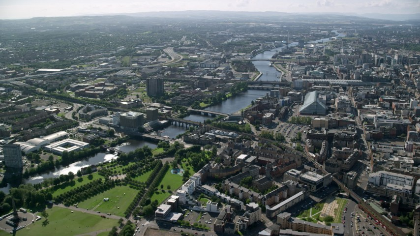 6K stock footage aerial video of River Clyde and bridges near city buildings, Glasgow, Scotland Aerial Stock Footage | AX110_162