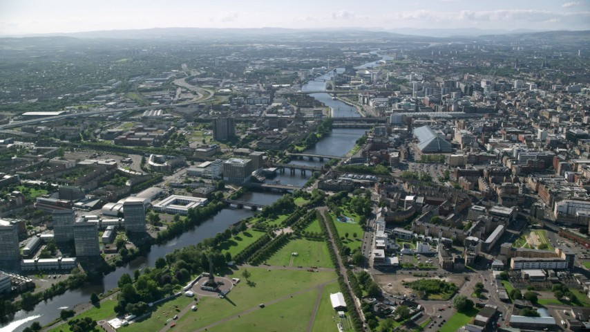 6K stock footage aerial video of River Clyde and bridges near city buildings, Glasgow, Scotland Aerial Stock Footage | AX110_163