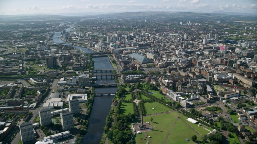 6K stock footage aerial video of the River Clyde with bridges among city buildings, Glasgow, Scotland Aerial Stock Footage | AX110_164