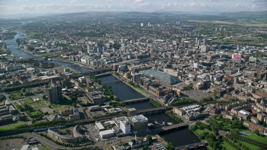 6K stock footage aerial video of River Clyde with bridges and the city of Glasgow, Scotland Aerial Stock Footage | AX110_166