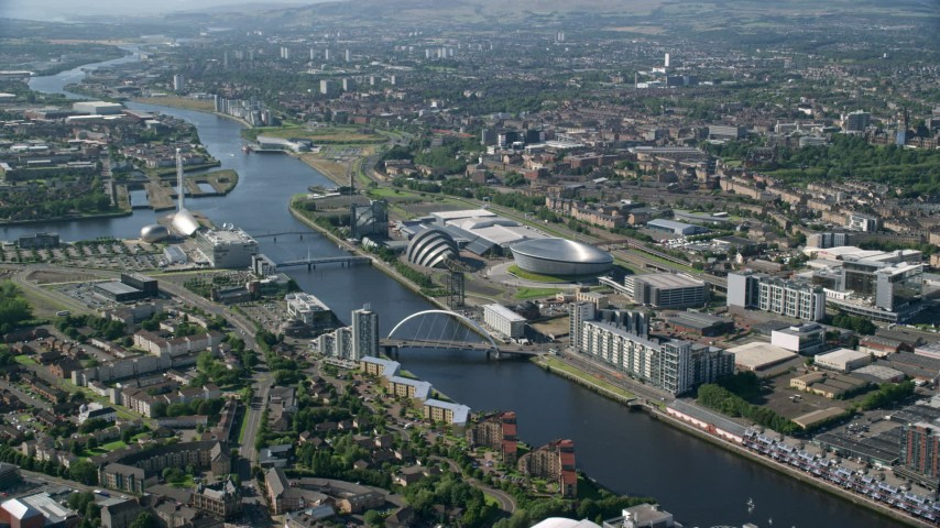 6K stock footage aerial video of Scotland's National Arena and Clyde Auditorium along River Clyde, Glasgow, Scotland Aerial Stock Footage | AX110_169
