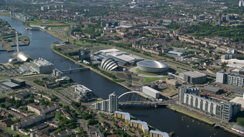 6K stock footage aerial video of Scotland's National Arena and Clyde Auditorium beside River Clyde, Glasgow, Scotland Aerial Stock Footage | AX110_170