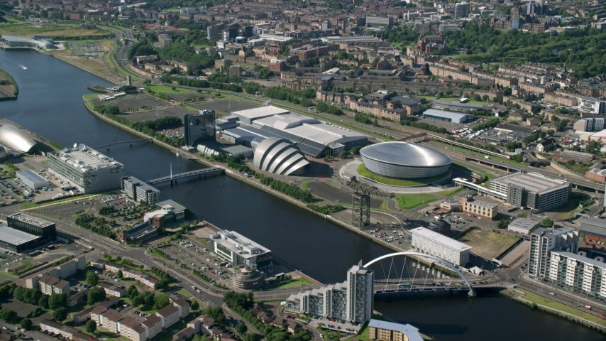 6K stock footage aerial video of Scotland's National Arena and Clyde Auditorium across River Clyde, Glasgow, Scotland Aerial Stock Footage | AX110_171
