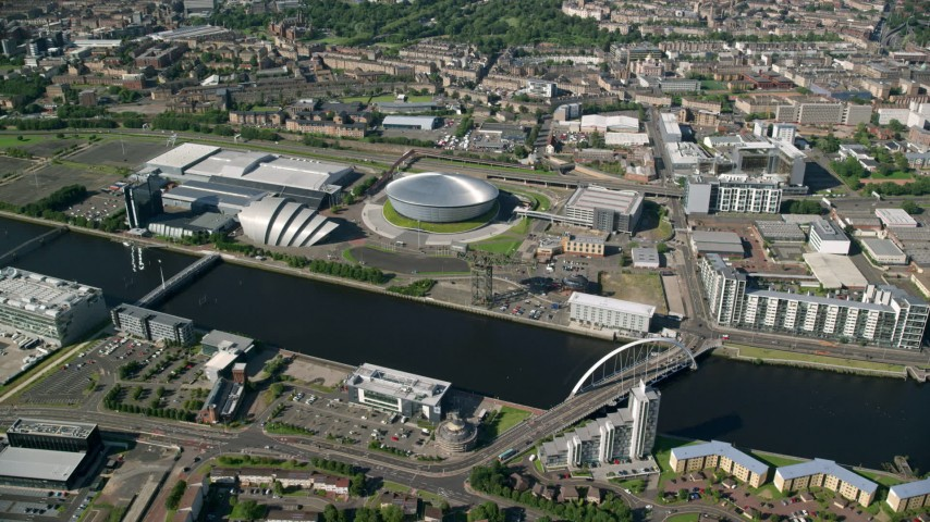 6K stock footage aerial video of Scotland's National Arena and Clyde Auditorium beside the River Clyde, Glasgow, Scotland Aerial Stock Footage | AX110_172
