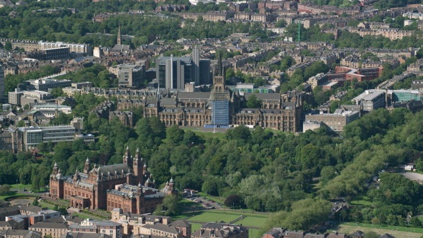 6K stock footage aerial video of the University of Glasgow and Kelvingrove Art Gallery and Museum, Scotland Aerial Stock Footage | AX110_173