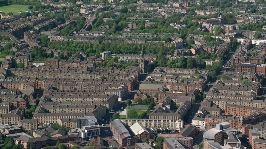 6K stock footage aerial video of rows of apartment buildings, Glasgow, Scotland Aerial Stock Footage | AX110_175