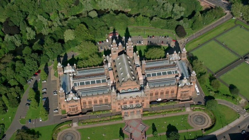 6K stock footage aerial video of bird's eye of Kelvingrove Art Gallery and Museum, Glasgow, Scotland Aerial Stock Footage | AX110_178