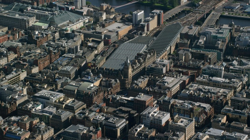 6K stock footage aerial video of Glasgow Central train station, Scotland Aerial Stock Footage | AX110_182