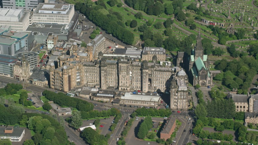 6K stock footage aerial video of the Glasgow Royal Infirmary hospital in Scotland Aerial Stock Footage | AX110_184