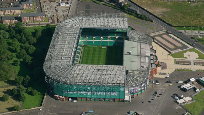 6K stock footage aerial video approach Celtic Park soccer stadium in Glasgow, Scotland Aerial Stock Footage | AX110_187