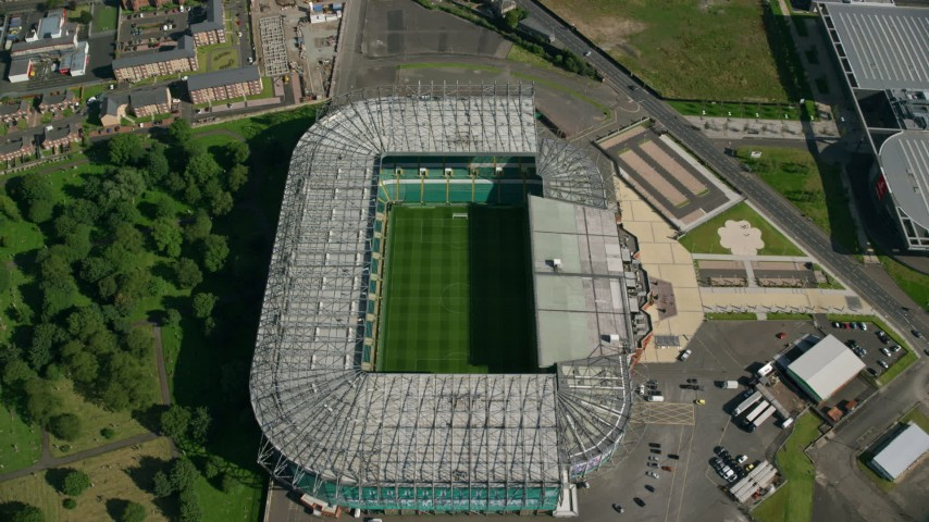 6K stock footage aerial video tilt to bird's eye of the soccer field in Celtic Park Stadium, Glasgow, Scotland Aerial Stock Footage | AX110_188