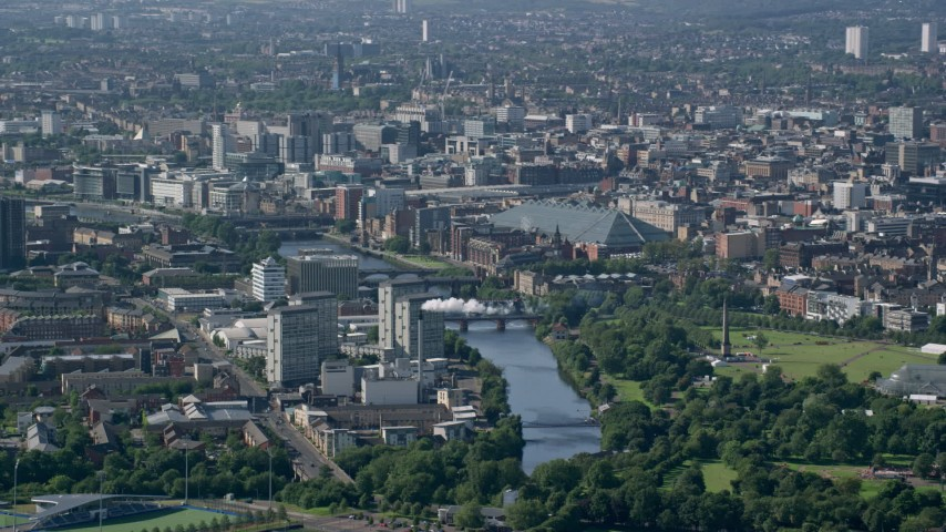 6K stock footage aerial video of River Clyde flowing through Glasgow, Scotland Aerial Stock Footage | AX110_191
